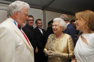 Dave Thompson, Pool/Associated Press - FILE - Queen Elizabeth II meets Rolf Harris and Kylie Minogue backstage at The Diamond Jubilee Concert in London in this Monday June 4, 2012 file photo . Harris, a veteran entertainer who has released hit singles and painted Queen Elizabeth II's portrait, has been arrested as part of a police investigation into sexual abuse allegations stemming from the Jimmy Savile scandal, British media